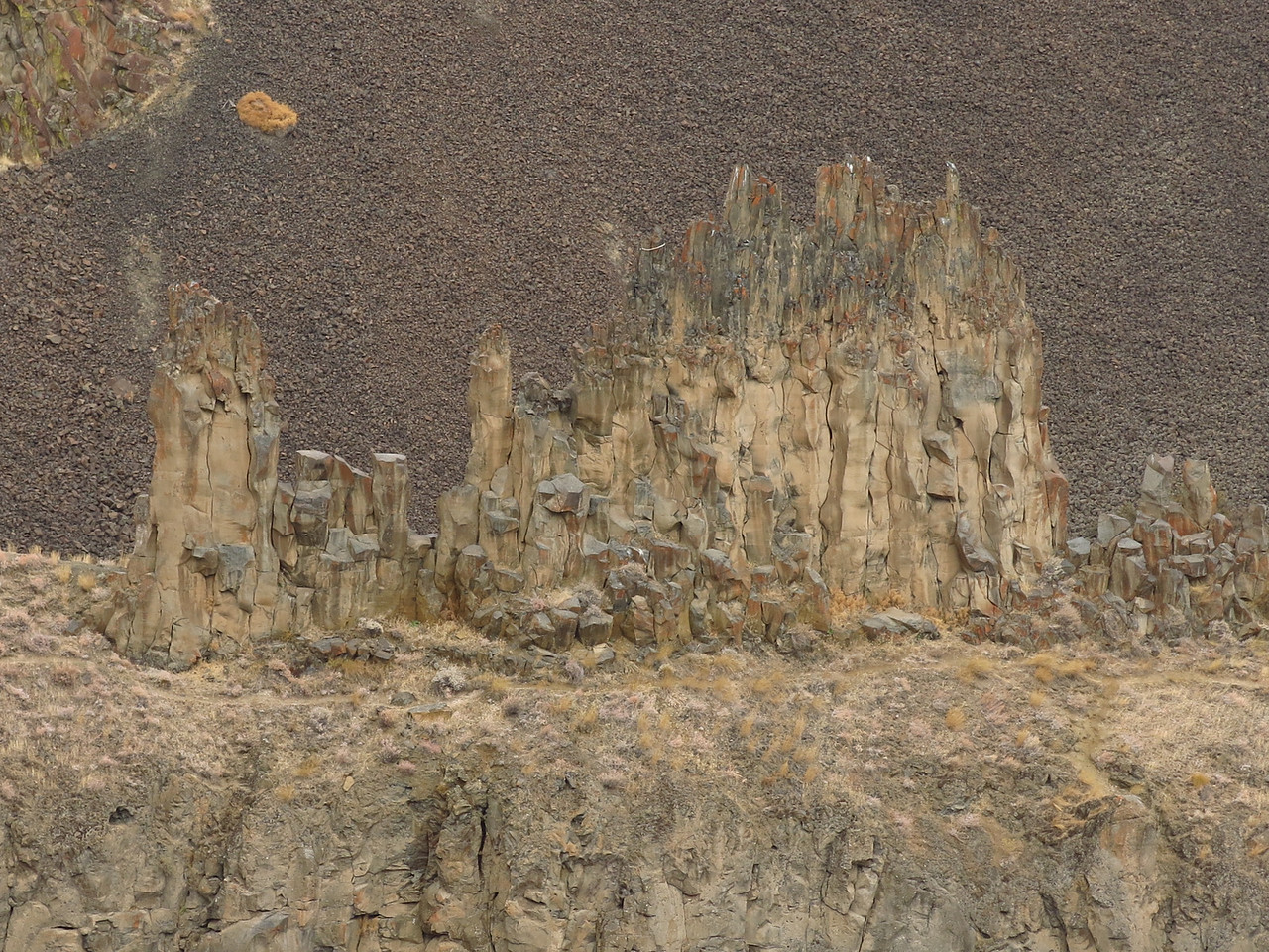 This is all that remains of one lava layer above the falls.  The shapes suggest columnar basalt.