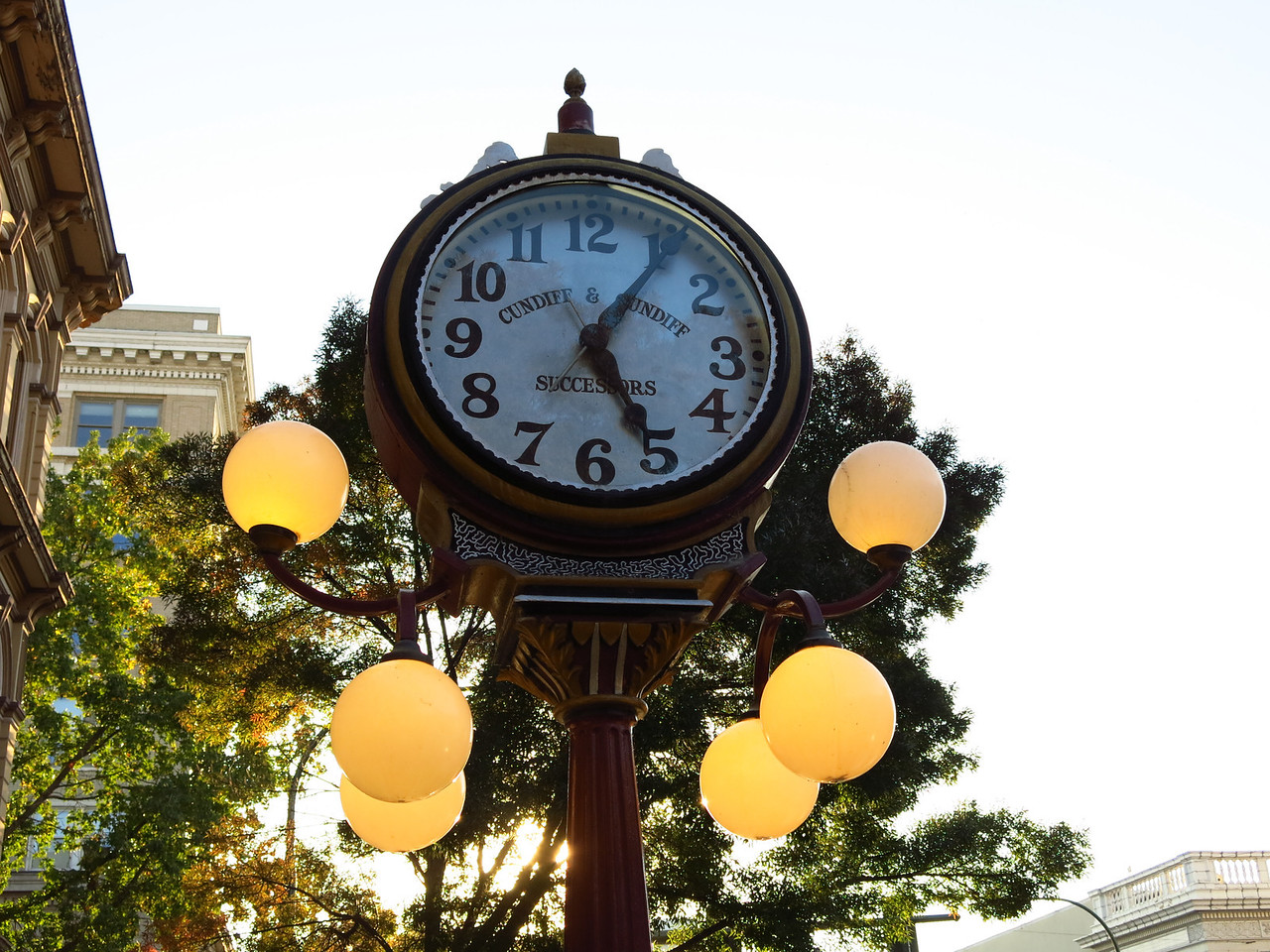 A clock on the sidewalk on Main Stree.