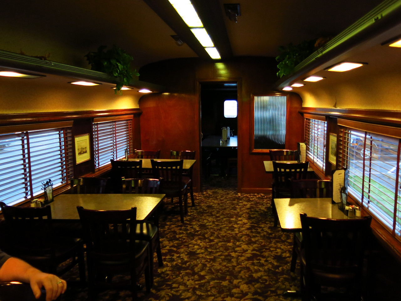 In the train car at the restaurant.